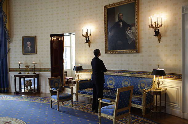 Obama Looking At One Of The Paintings In His Office