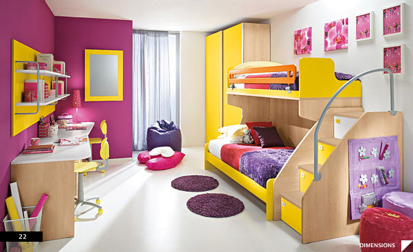 The brilliant color combination of the beds, area rugs , closet units ...
