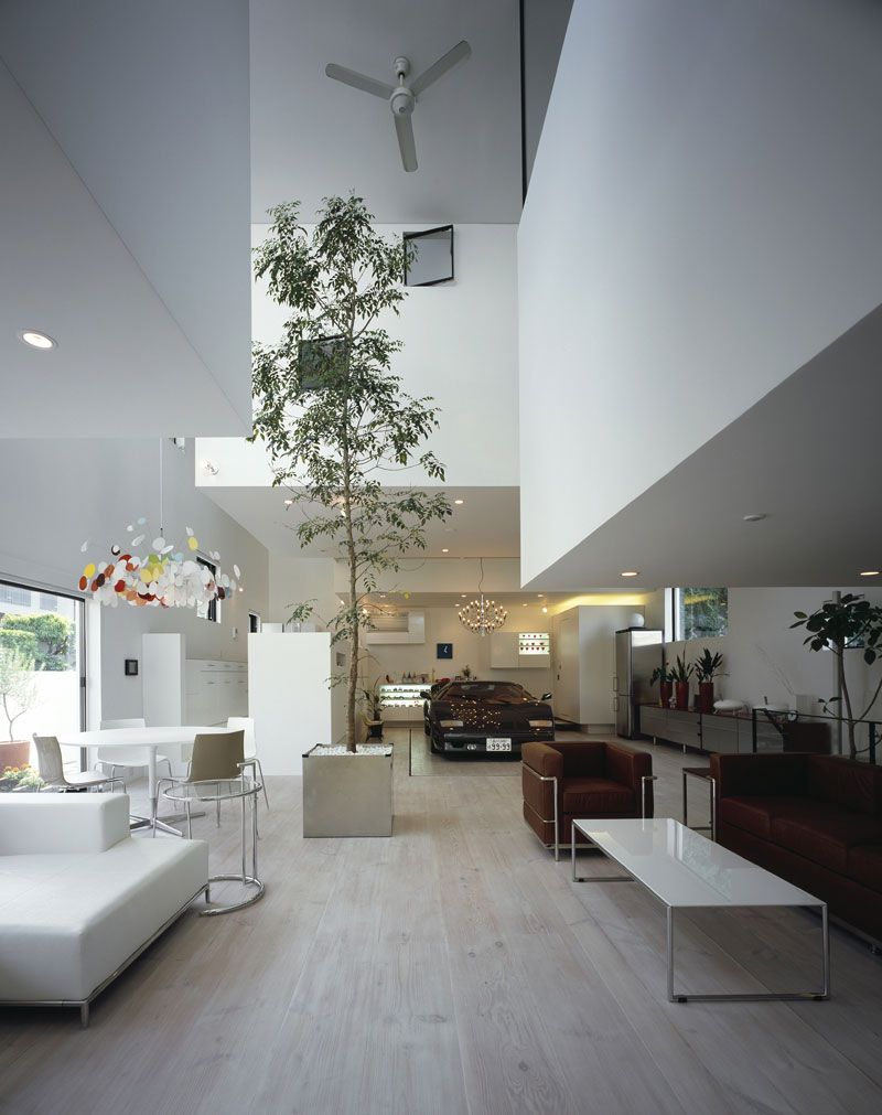 The House That Parks A Lamborghini In The Living - White interior house