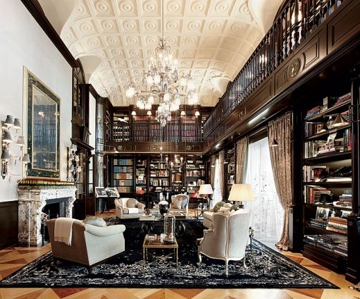 this elegant two story library is every bookworm s dream lounge