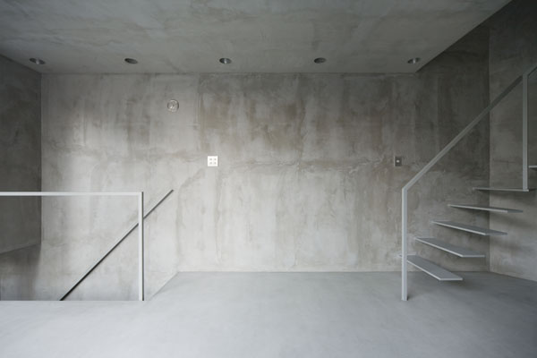 thin tokyo apartment landing concrete floor to ceiling