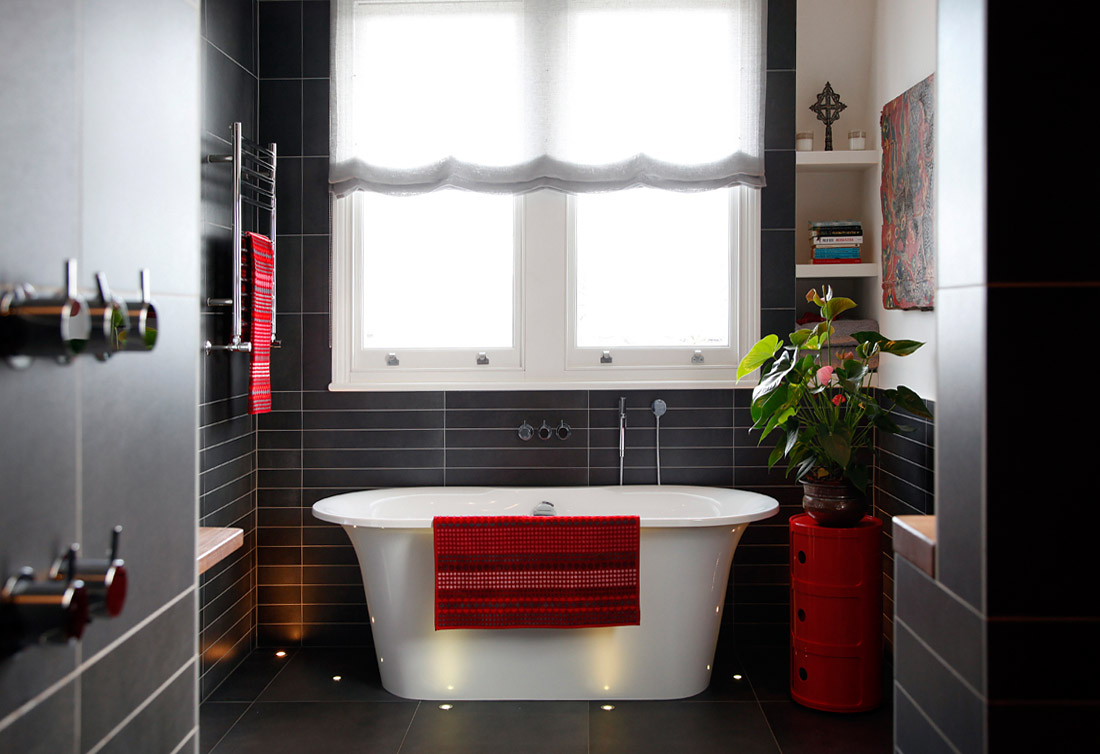 House tour beautiful modern black tile bath red accents for Dark grey bathroom accessories
