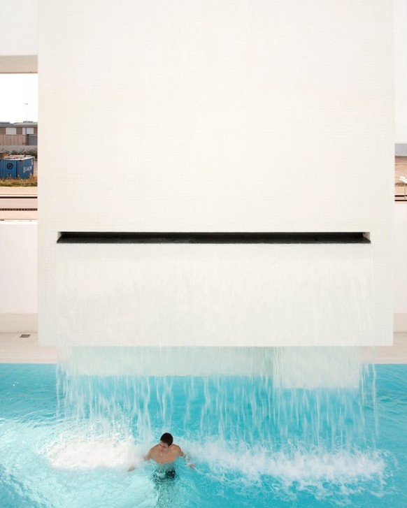 waterfall pool design Les Bains Des Docks Aquatic Center