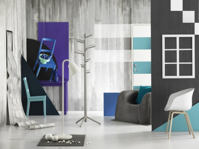 blue chair on wall in grey room