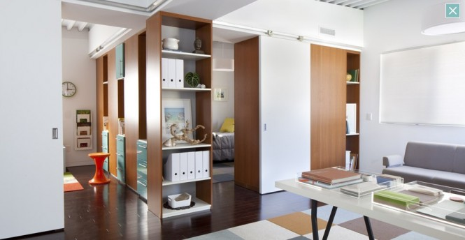 The shelves are movable and may serve as partitions between rooms. In fact, the entire second floor of the house is the Flex Zone and can easily be upgraded from a 2-bedroom to a 3-bedroom simply by moving the storage units (that all float on casters) around.