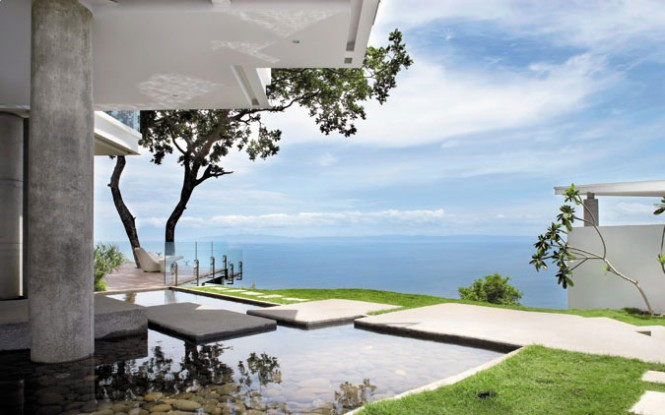 The house boasts a spectacular view of the blue Costa Rican waters, and parts of it even float atop a rock-filled pond.