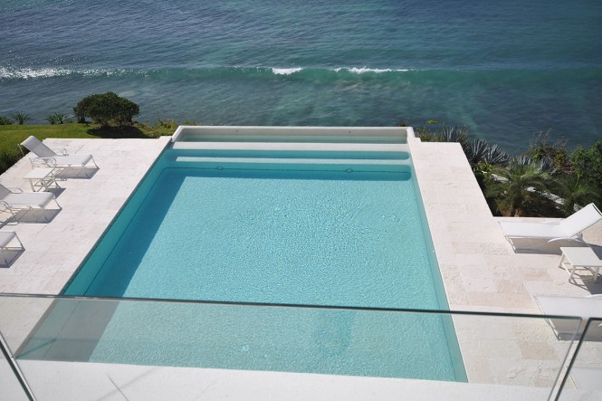 The modern pool almost spills out to the bay.