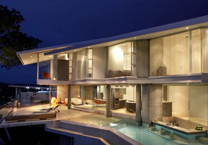 The entire house is covered in glass, instead of solid walls--to take total advantage of the majestic view.