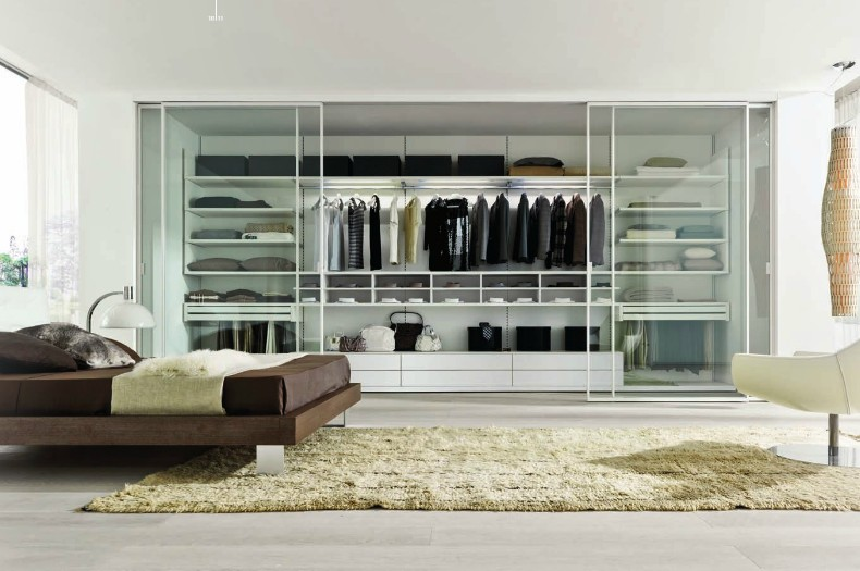 This Particular Closet Space Is Installed Inside The Wall And Includes  Glass Door Panels That Slide