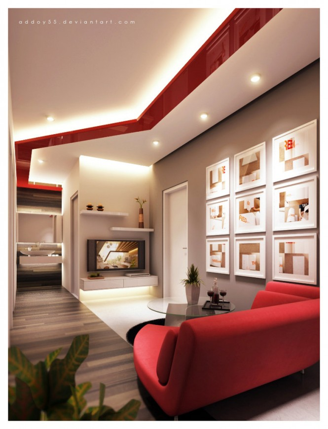 This modern living room combines white and red, with a modern vibe and angled high ceilings with recessed lighting. It is simple yet dramatic.
