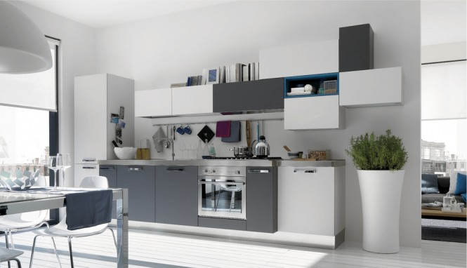 The cabinetry here is interesting, jumping from white to grey to blue.