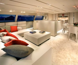 Driftwood plucked from the Caribbean shores, were used as color and texture inspiration for the interiors, and were repeated throughout the yacht for a harmonious effect. Some doors are only distinguished by their metal handles.