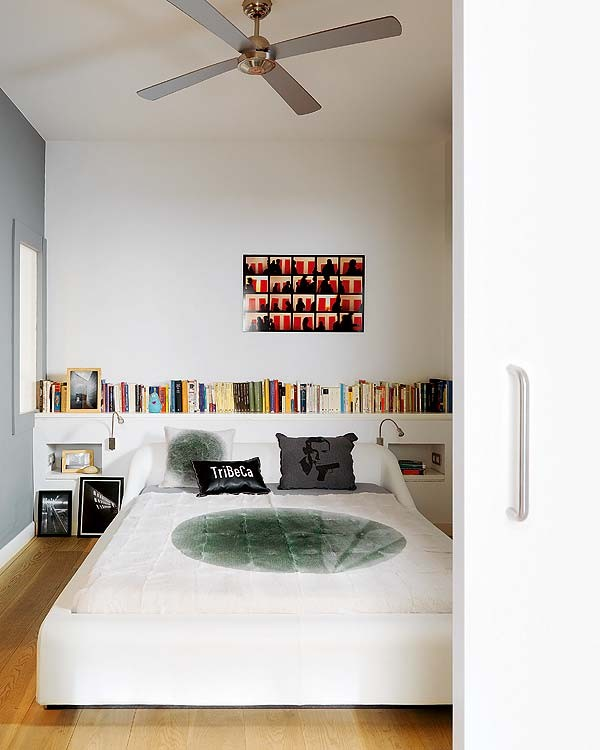 The bedroom is simply artsy with pieces that evoke New York City and graphic art that makes it edgy.