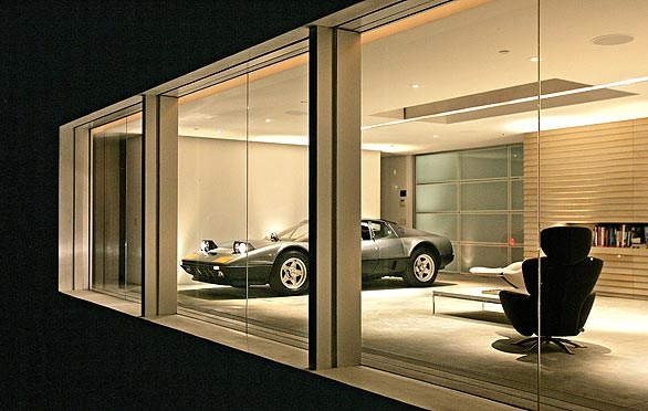 Cars parked inside homes pretty or pretty weird for Home plans with photos of inside and outside