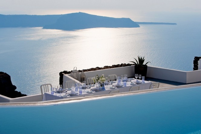 grace santorini infinity pool balcony and ocean view