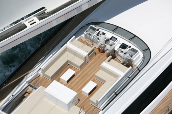 The flybridge deck, a white superstructure above the main deck, is the action area.