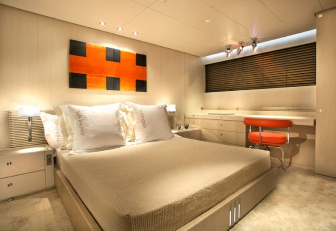 The master bedroom, like the rest of the rooms in the yacht, is paneled with rectangular pieces of matte - varnished, blonde oak. Pale charme planks line the living room floors, while silk carpeting decorates the bedroom floor.