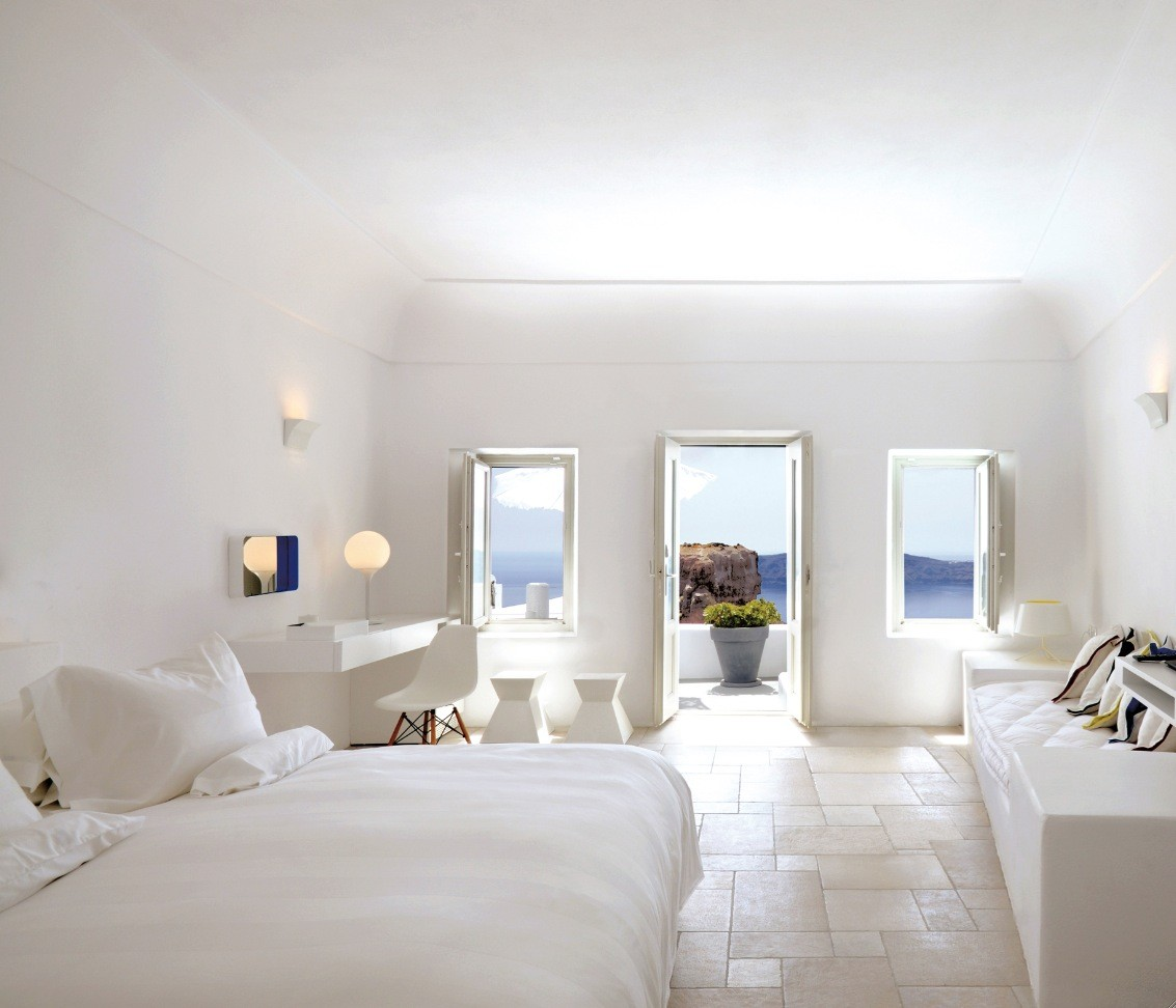 Santorini large white bedroom with balcony and view for Bedroom designs white