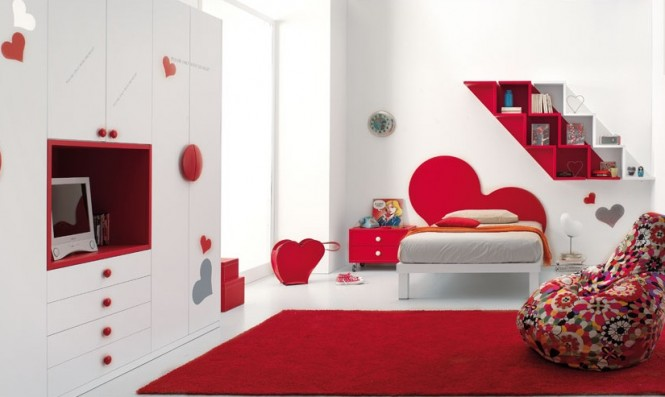 This quirky red and white bedroom, incorporates heart cut out designs throughout. We think it's perfect for a young girl's bedroom.
