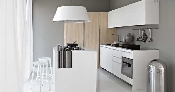 Smaller White Kitchen with Light Wood Elements