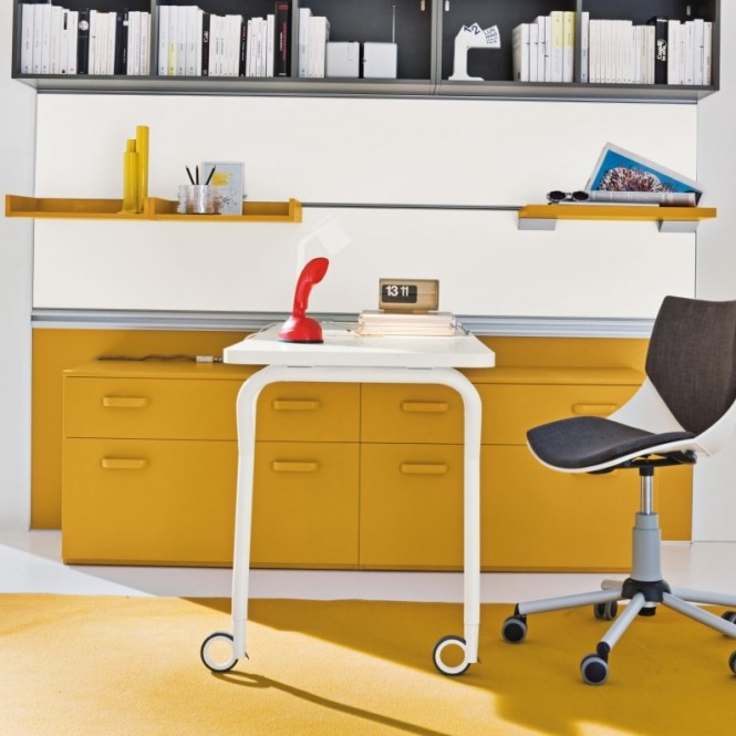 A desk that is mounted partially on castors, and completed by fixture to a wall track, creates an ingeniously compact, yet versatile work space solution!