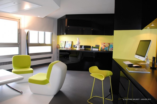 Via Loft DesignThese gloss black units are striking with a pop of citrus.