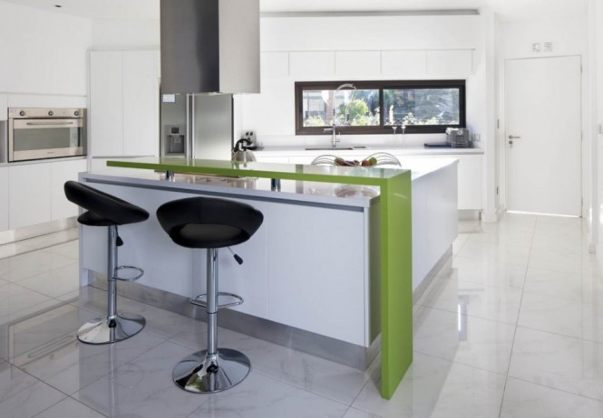 A stripe of green adds edge to a simple white kitchen scheme