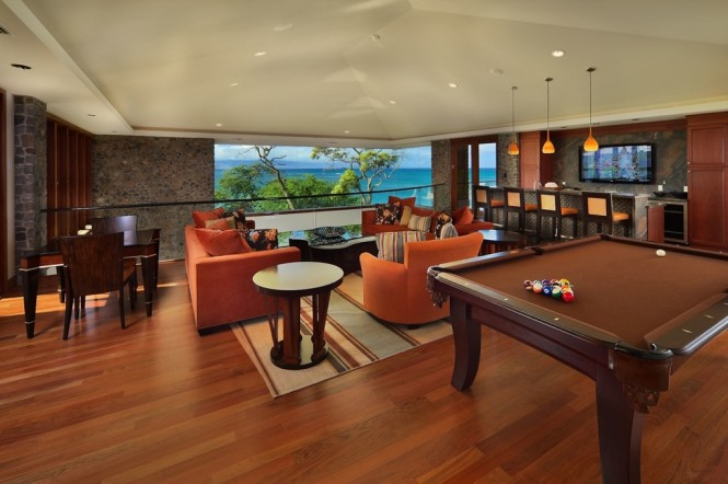When you have had enough of the pool and the sun is setting, an extensive games room with pool, games tables and even a home sports bar awaits you inside the property.