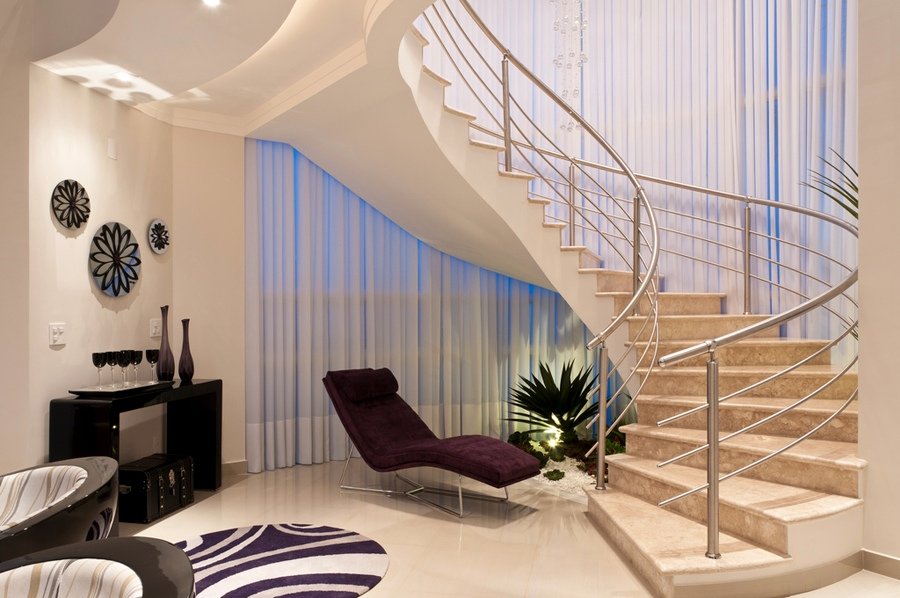5 cream plum living space hallway sweeping staircase for Interior design of living room with stairs