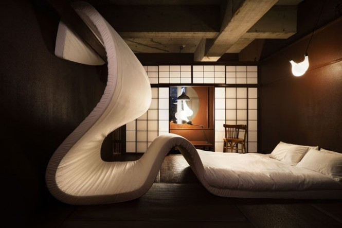 Via Love Themed Hotel in TokyoThis mattress gone mad undulates over a hotel room at the LLove pop up hotel in Tokyo.