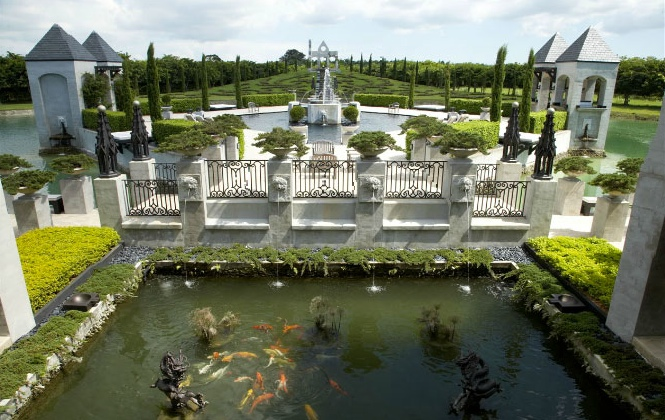 Built in 2007, it spans 10,124 square feet in total, and sits within 13.74 acres. The grounds are a stunning example of landscape architecture, featuring multiple raised walkways that overlook lavish fishponds and spout elegant water fountains.