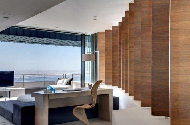 Main living areas and sleeping quarters are divided by sculptural wooden paneling, which are both function and form, a sophisticated neutral décor runs throughout the building in it's entirety, effectuating a seamless space that is cohesive in color and mood.