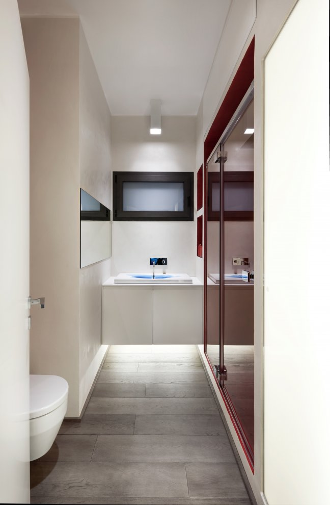 Large storage cabinets and wall mounted sanitary ware makes great use of space in the bathroom.