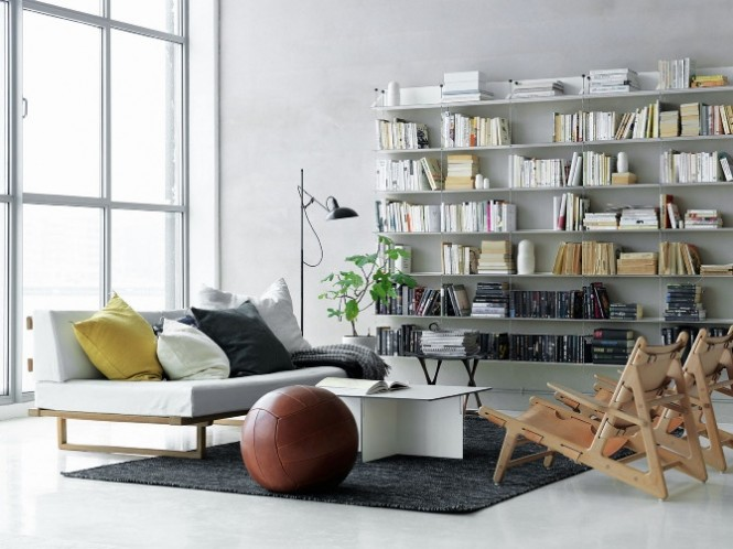 white scandinavian living room bookshelves