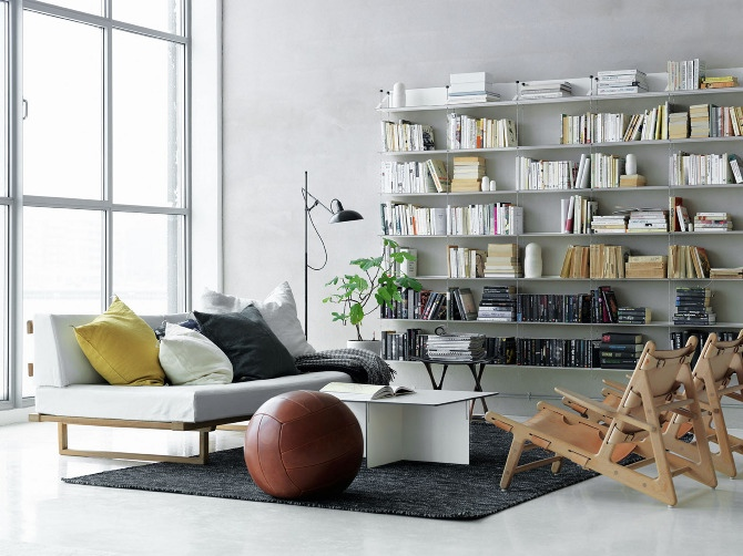 white scandinavian living room bookshelves interior