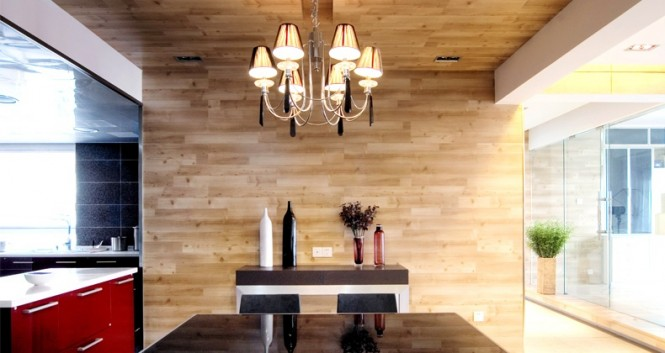 wood clad wall red kitchen