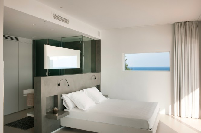 The simple interior design creates a holiday home ambience with its neutral scheme and open plan living areas. The sleeping quarters also take on a flowing layout with a wash area located directly behind the headboard; this layout allows the beautiful views visible from your bed to be viewable from your shower too–luckily there is a modesty screen to stop beach dwellers from having a view of you too!