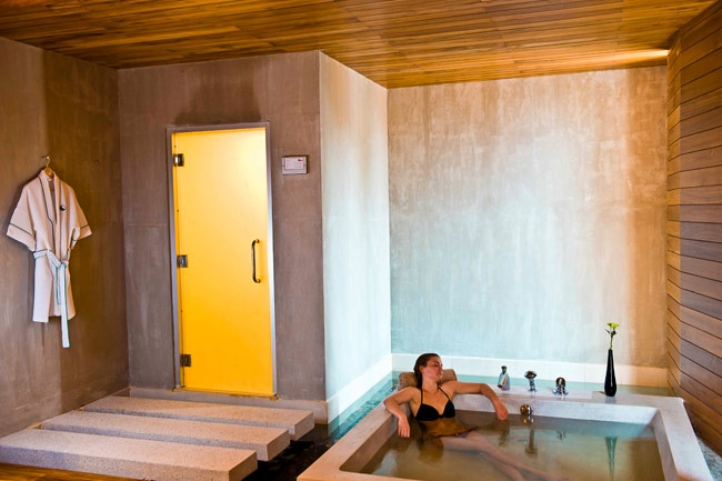 Each holiday dwelling boasts a romantic two-person bathtub bathed in natural sunlight from a huge window surrounded by modern decor, and a plush separate rain shower.