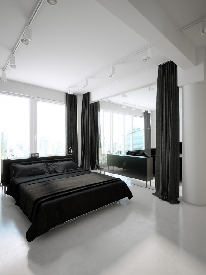 In the bedroom, the monochromatic drama continues, with theatrical floor to ceiling black drapes that screen off an internal window to the living area, when more privacy is desired, and are repeated at the external window to block out the daylight.