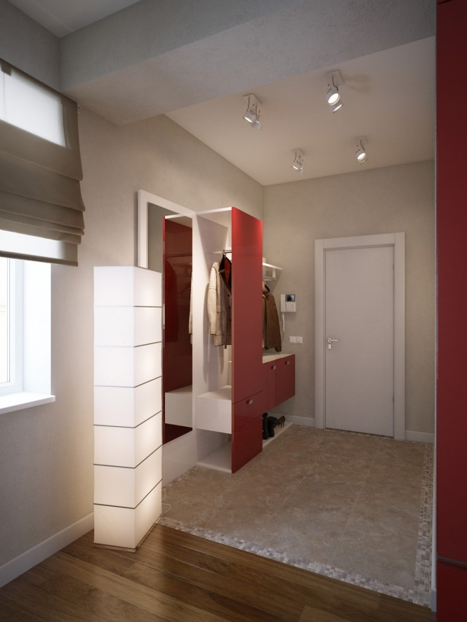 In the entranceway, the first flecks of red furniture can be found in the form of contemporary coat and shoe storage, which reflects the start of the bright kitchen run on the left hand side.