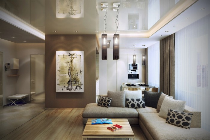 The same lighting and color palette has been used throughout the living spaces to create a flowing and seamless effect from entranceway to lounge area, to kitchen diner.