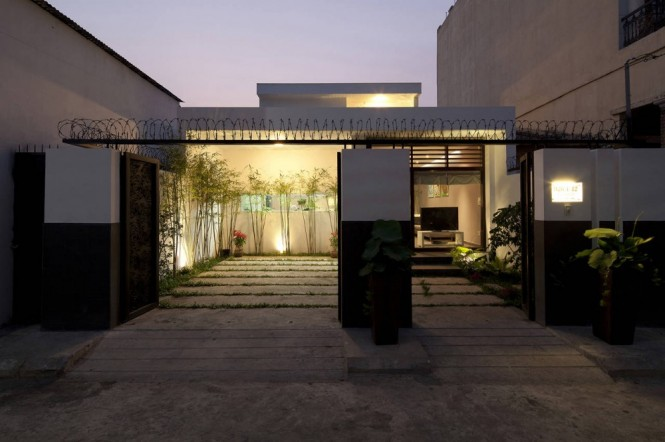 Located in Ho Chi Minh City, a residential district of Saigon, Vietmam, this brand new build spans 255 sqm. The dwelling was designed as a family home for a couple with 3 young children, resulting in a contemporary taste throughout but maintaining a practical edge.