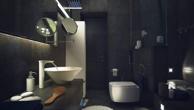 A more dressed dramatic look blankets the bathroom, with dark tiling over walls and floor, brightened only by the punctuation of white sanitary ware. The stark contrast results in an extremely crisp and tailored look, and the addition of a vanity shelf clad in the same large tile makes everything appear seamless, as though the fixtures have organically emerged from the walls themselves.