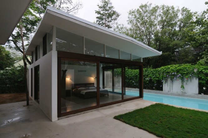 Poolhouse bedroom floor to ceiling windows