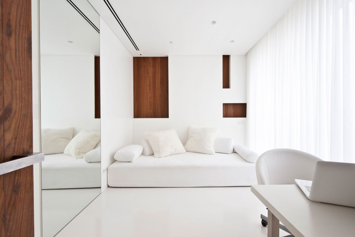 Apartment awash with walnut white White home design ideas