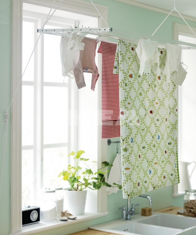 This wash area becomes a practical clothes-drying space with the addition of a ceiling mounted rack, which can be lowered on a pulley for loading and unloading.