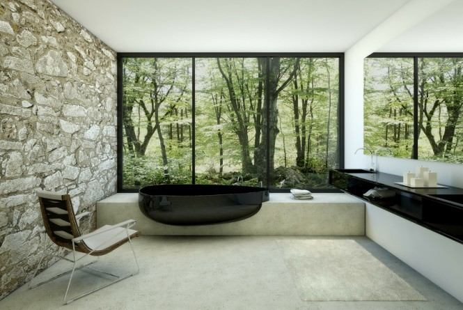 A glossy pebble shaped bathtub emerges from a solid concrete surround for a stunning contrast of style.