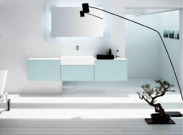 A singular bonsai commands attention and looks great in a minimalist space like this contemporary bathroom. Be sure to keep them out of reach if your have children or pets in the home though, not only will your precious plant be ruined by curious hands and paws but many plants are toxic.