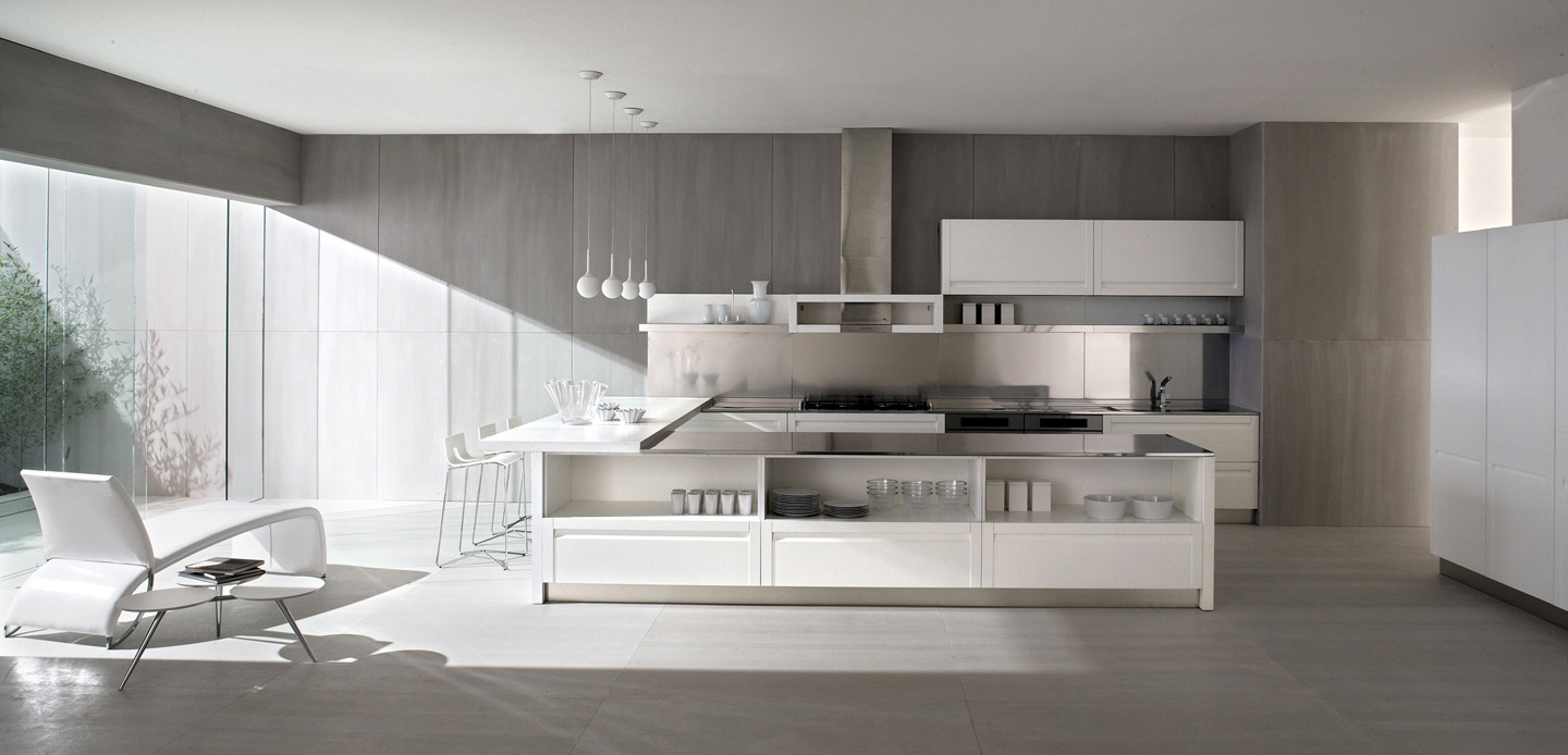 an ice white layout gives a clean visual and these handleless cupboards work towards a