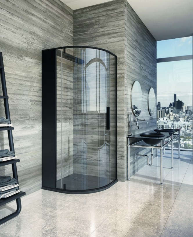 A curved corner shower enclosure gives flow to the angular situation, whilst a strong black finish provides edgy framing, and compliments the dark masculine vanity unit nearby.